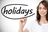 Businesswoman writing word holidays — Foto Stock