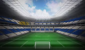Флаг Уругвая против футбольный стадион — Стоковое фото