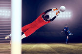 Goalkeeper in red jumping up — Stock Photo