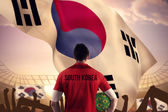 South korea football player holding ball — Stock Photo
