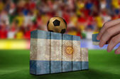 Hand building wall of argentina flag — Stockfoto