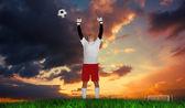 Goalkeeper in white cheering — Stockfoto