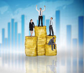 Composite image of business people on pile of coins — Stok fotoğraf