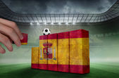 Hand building wall of  spain flag — Stockfoto