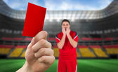 Hand holding up red card to player — Stock Photo