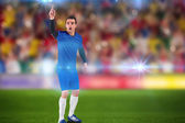Football player raising his hand — Stock Photo