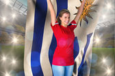 Football fan holding uruguay flag — Stok fotoğraf