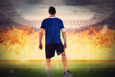 Football player against  football stadium — Stockfoto