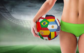 Fit girl holding flag football — Stock Photo