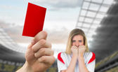 Hand holding up red card to fan — Stock Photo