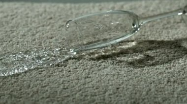 Glass of water spilling on carpet — Vidéo