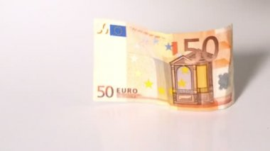 Euro notes dropping on white surface — Stock Video