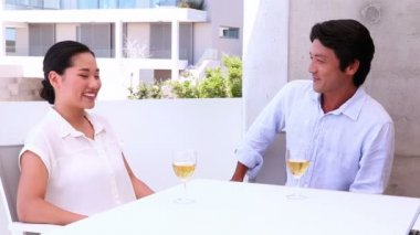 Asian couple having white wine — Stock Video