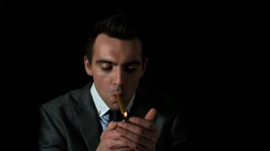 Businessman lighting his cigar — Stock Video