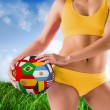 Girl in bikini holding flag footba — Stock Photo #48250477