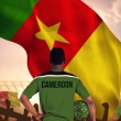 Cameroon football player holding ball — Stock Photo