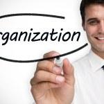 Businessman writing word organization — Stock Photo #48253109