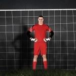 Goalkeeper against goal net — Stock Photo #48253133