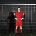 Goalkeeper against goal net — Stock Photo