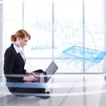 Redhead businesswoman using laptop — Stock Photo #48255147
