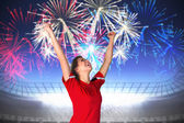 Cheering football fan in red — Stock Photo