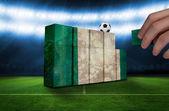 Hand building wall of nigeria flag — Stockfoto