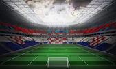 Croatia national flag against football stadium — Stock Photo