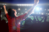 Cheering football fan in red jersey — Stock Photo