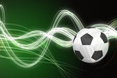 Football against curved laser light — Stock Photo