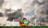 Football in multi national colours — Stock Photo