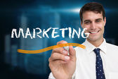 Businessman writing word marketing — Стоковое фото