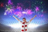 Excited asian football fan cheering — Stock Photo