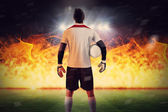 Goalkeeper against football pitch — Stock Photo