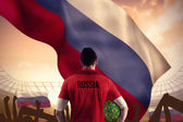 Russia football player holding ball — Stock Photo
