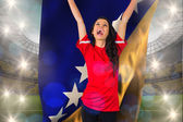 Football fan holding bosnian flag — Stock Photo