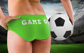 Girl in bikini holding football — Stockfoto