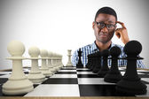 Confused businessman with chessboard — Stock Photo