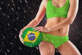 Girl holding brasil ball — Stock Photo