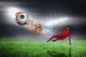 футболист в красный ногами — Стоковое фото