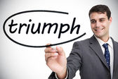 Businessman writing word triumph — Stockfoto