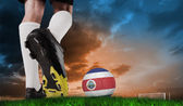 Football boot kicking costa rica ball — Stock Photo