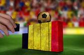Hand building wall of  belgium flag — Stockfoto