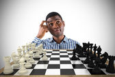 Thinking businessman with chessboard — Stock Photo
