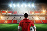 Composite image of swiss football player holding ball — Stock Photo