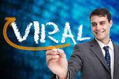 Businessman writing word viral — Stock Photo