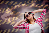 Brunette listening to music — Stockfoto