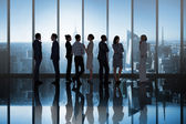 Business colleagues talking in room — Stock Photo