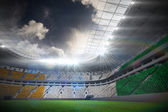 Ivory coast flag against football stadium — Stock Photo