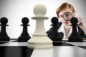 Businesswoman with magnifying glasses with chessboard — Stock Photo