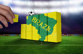 Hand building wall of green brazil outline — Stock Photo